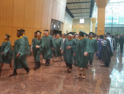 Graduates at the January 2015 commencement ceremonies process into the graduation hall as they are applauded by Wilmington University professors, instructors and administrators.