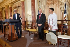 U.S. Secretary of State John Kerry delivers remarks at the U.S. Chairmanship of the Arctic Council reception with Special Representative for the Arctic Admiral Robert Papp before Byron Nicholai performs a song in Yup'ik, a native Alaskan language, at the U.S. Department of State in Washington, DC on May 21, 2015. [State Department Photo/Public Domain]