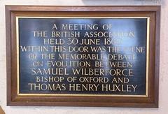 Photo of Thomas Henry Huxley and Samuel Wilberforce black plaque