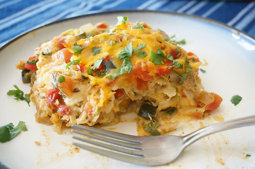 A serving of King Ranch chicken, closeup shot, with a fork in the foreground