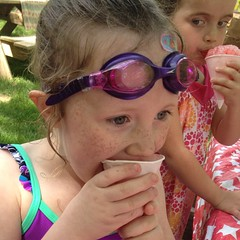 Teagan didn't even wait to take off her #goggles. Ash looks like she wants to take it. look at that #eyeball. #snocone #omnomnom #summerfun