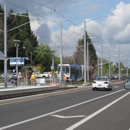A one-car train approaches 17th & Holgate