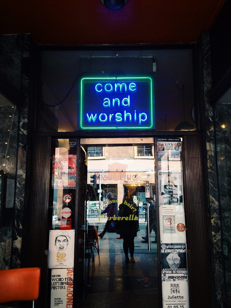 neon sign pop boutique Manchester front door
