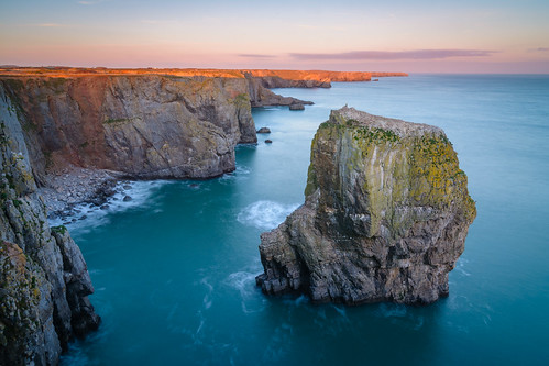 sunset sea wales unitedkingdom stack pembrokeshire elegugstacks