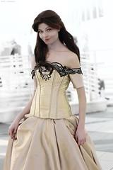 bridal clothing(0.0), undergarment(0.0), wedding dress(0.0), pattern(1.0), neck(1.0), textile(1.0), gown(1.0), clothing(1.0), abdomen(1.0), sleeve(1.0), cocktail dress(1.0), satin(1.0), dress(1.0),