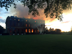 Firefighters tackle a blaze at Clandon Park