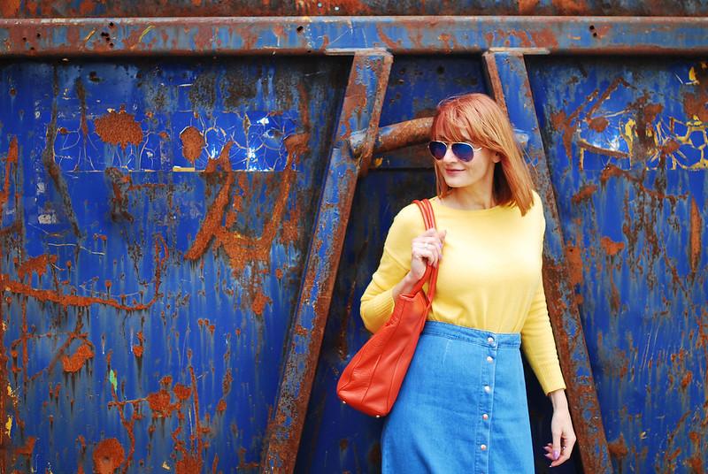 Primary brights colour blocking: Yellow sweater, denim midi skirt, orange tote bag, | Not Dressed As Lamb