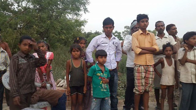 Children and other curious onlookers from Bhat Nayya village.