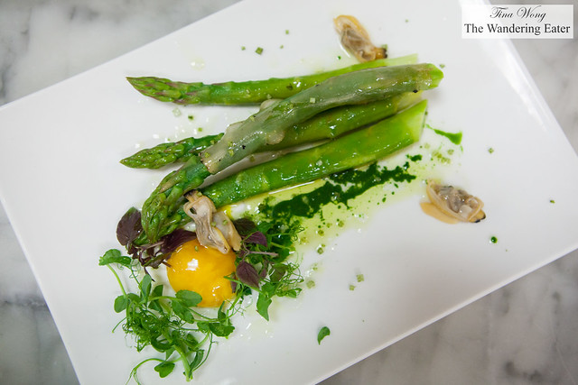 Butter poached asparagus, cured (partially cooked) egg yolk, watercress oil, and clams
