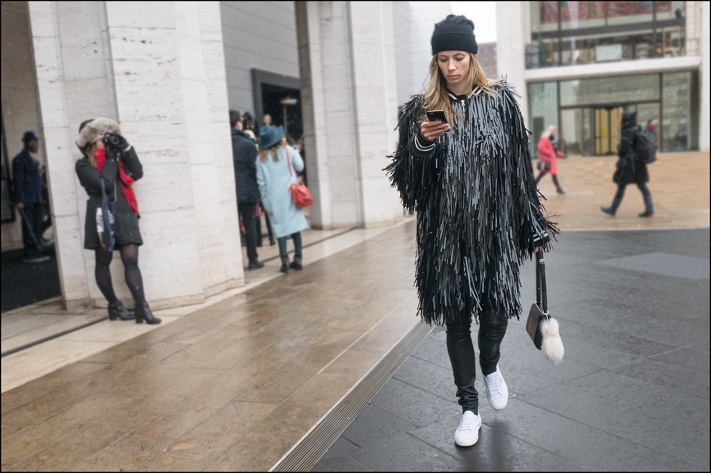 FW2-15  59w plastic strip coat black leather leggings knit cap white runners black purse white fur tail