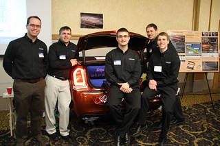 Chrysler 300 Split Tailgate Team posing with poster