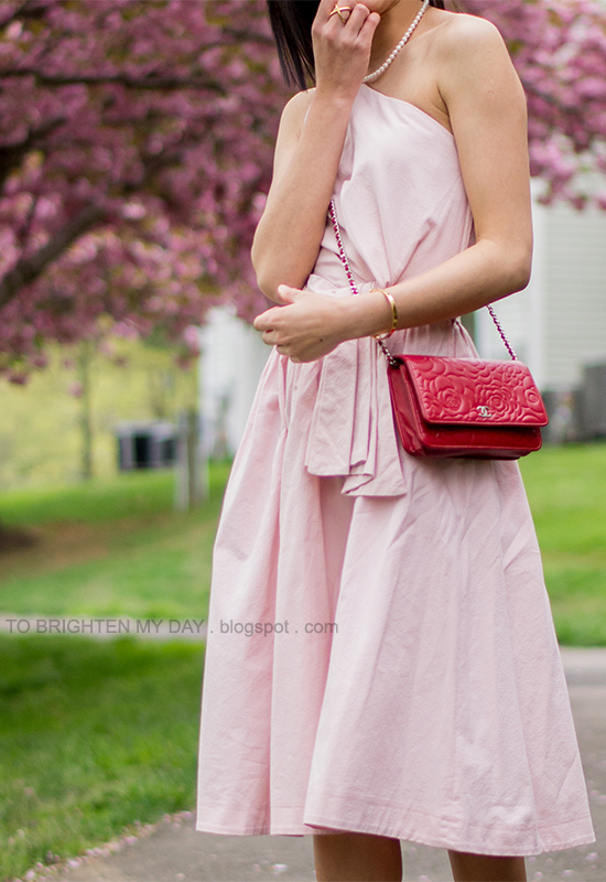 pink cutout midi dress, red crossbody bag