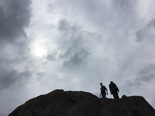 sky silhouette rock outdoors day explore daytime skyandclouds twopeople silhuette rockformation moodysky
