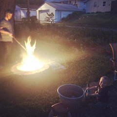 The big brother is tending the fire while the little one's playing in the water bucket. Opposites in pretty much everything with these two.
