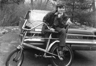 Yours truly looking young and hip atop my trusty Raleigh Chopper bike (with requisite STP sticker) and Dad's black 1965 Pontiac Bonneville behind me. Milford Connecticut. April 1972.
