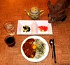 Seara (sea rabbit). Photo by Dr. Takeshi Yamada. 20120312 035 Japanese Chicken Curry Rice with raw egg. Pickled Bok Choy. Tomato. Lemon Tea. Water.