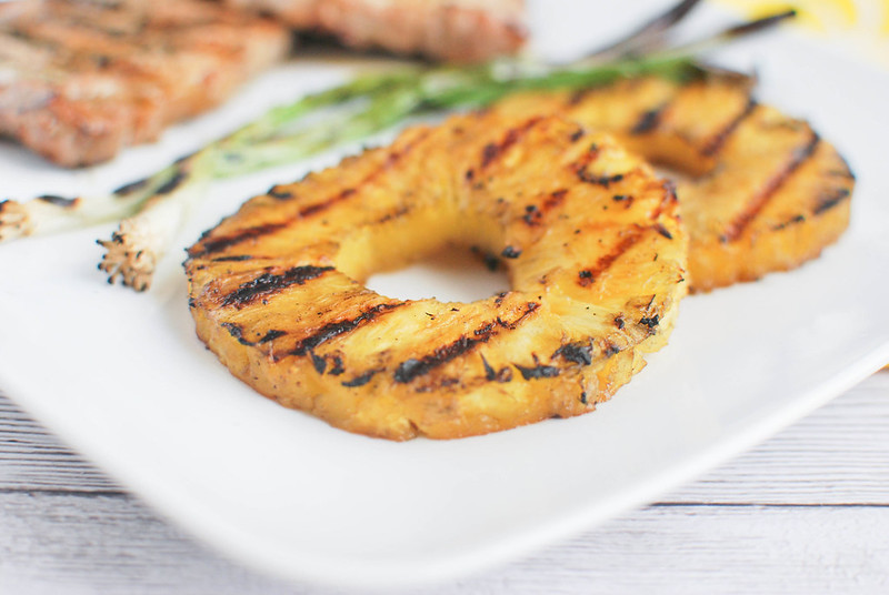 Grilled Ginger-Sesame Pork Chops with Pineapple and Scallions - pork chops marinated in a ginger sesame citrus marinade and grilled with pineapple and green onions.