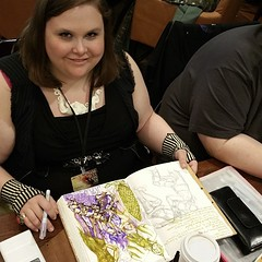 Here is a  @tiphoni working in her #journal at #norwescon .  #art #Tiphoni #sketch #draw #paint #Journaling #sketchbook #convention #con #scifi