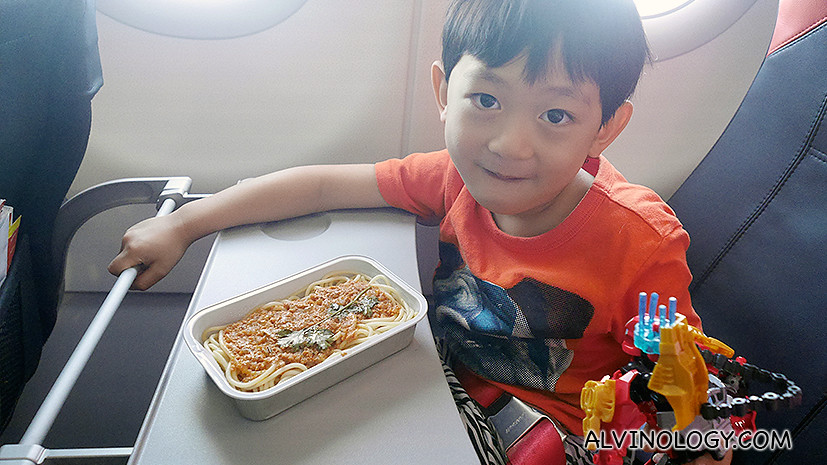 Asher enjoying a meatball spaghetti meal which we ordered for him