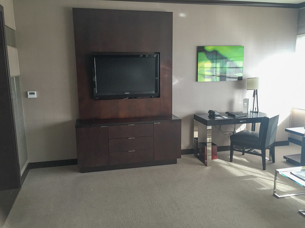 Desk, TV, and dresser in Deluxe suite