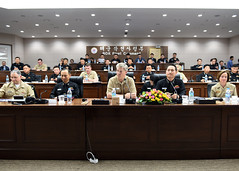Vice Adm. Robert Thomas, center, commander of U.S. 7th Fleet, prepares to deliver opening remarks to Republic of Korea Navy leadership during an anti-submarine warfare (ASW) cooperation committee meeting in Busan. (U.S. Navy/MC1 Abraham Essenmacher)