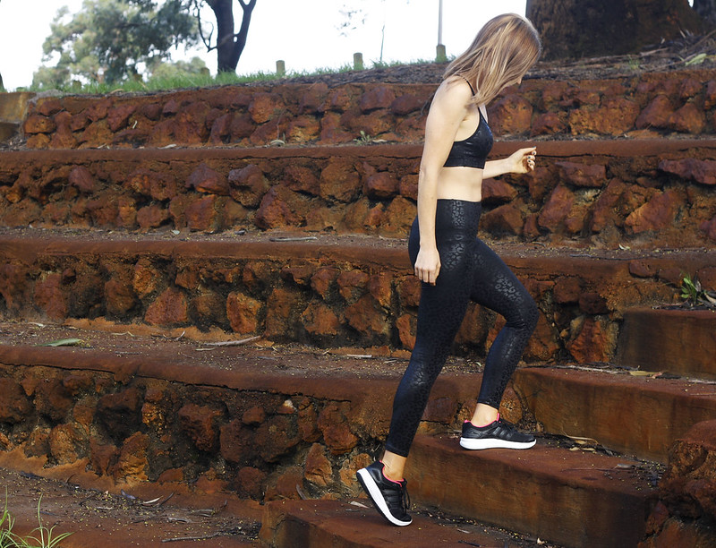 Fitness fashion wearing all black tights and crop