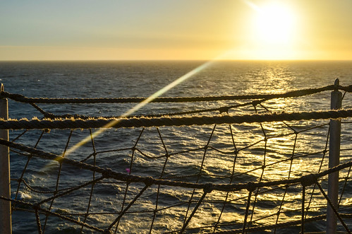 Sunset and nets at sea