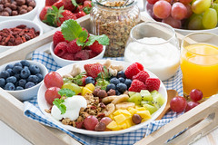 healthy breakfast - berries, fruit and cereal on t…