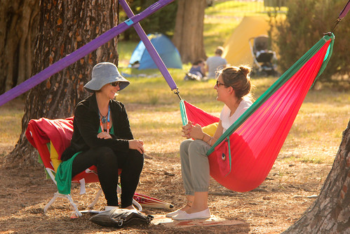 a hammocktime guide and a guest chatting after their session at WOMADelaide2015