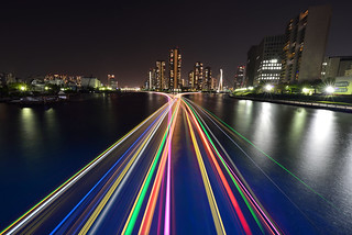 Light trace of houseboats and The Rivercity21 Towers at SumidaRiver EitaiBridge, Tokyo