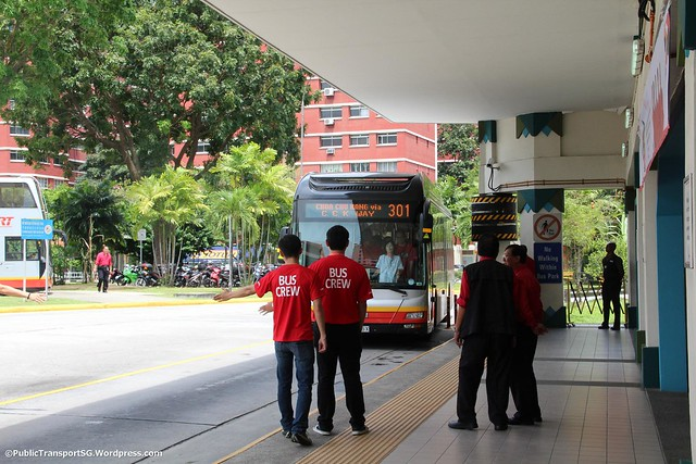 Exchanging greetings with the bus driver
