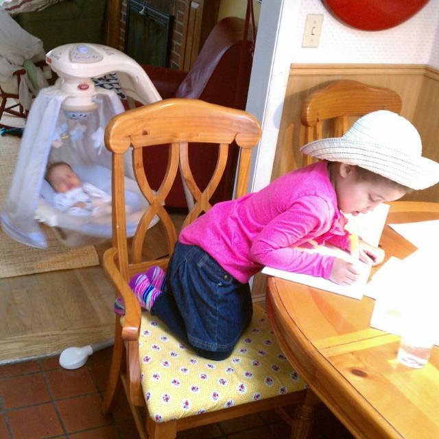Newborn is asleep, big girl is busy drawing. #timetosew