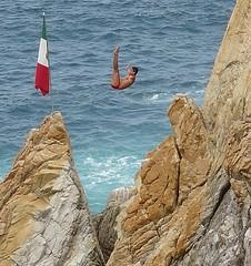 Super close up red bathing suit diver Acapulco