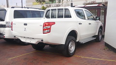 compact sport utility vehicle(0.0), nissan navara(0.0), automobile(1.0), automotive exterior(1.0), pickup truck(1.0), wheel(1.0), vehicle(1.0), truck(1.0), mitsubishi(1.0), bumper(1.0), mitsubishi triton(1.0), land vehicle(1.0),