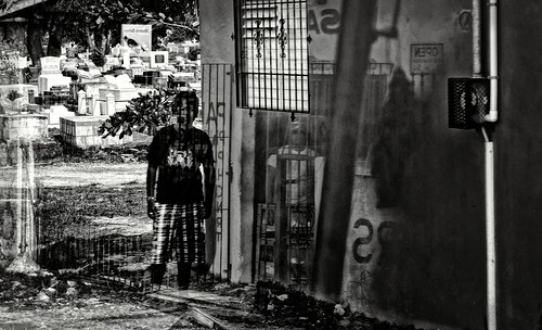 the boy and the ghost at cemetery- reflection in the bus window :)