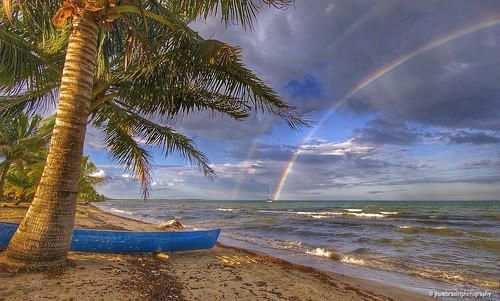 ocean sunset sea tree beach nature clouds sailboat landscape rainbow sand waves belize double palm shore tropical caribbean hopkins