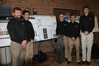 B-pillar Revision Project Team posing with poster