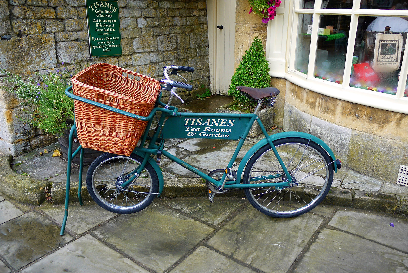 Delivery bicycle at Tisanes Tea Room in Broadway, Worcestershire. Credit Mick