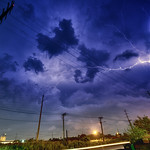 © 2015 Steve Kelley  Follow me on [ G+ ],   [ Facebook ] and, [ Twitter ]  Lightning storm shot under the PATH train bridge between Jersey City, NJ and Kearny, NJ.  Looking West and the badlands of New Jersey.  Nikon D800