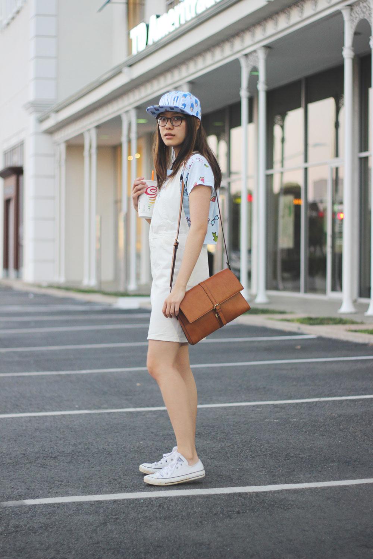 Baseball cap and white overall skirt