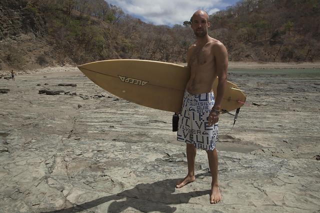 Ben with surfboard in Nicaragua