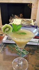 Kiwi Martini - fresh juiced kiwi and lime stirred over ice with vodka, Dolin Rouge Vermouth, Dolin Blanc Vermouth, Bittered Sling Grapefruit and Hops bitters. Garnished with kiwi wheel and mint.
