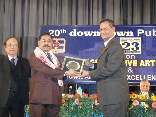 Dr Ali receiving an award in Guwahati for his service in population control.
