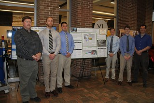 Dynamometer Calibration Device Team posing with poster