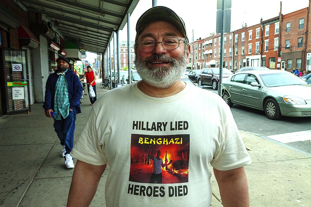Man-wearing-HILLARY-LIED-HEROES-DIED-T-shirt--Italian-Market