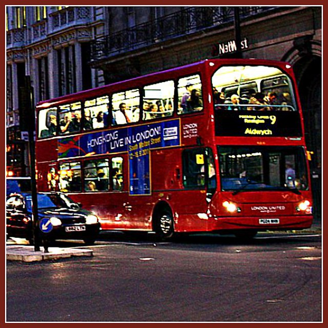 A double-decker bus Nighttime view in London