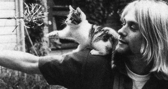 Kurt Cobain and a kitty show a fleeting moment of happiness in KURT COBAIN: MONTAGE OF HECK.