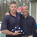 Chris Mallon returned home to New Fairfield after serving nine months in Iraq and Kuwait. Rep. Richard A. Smith thanked him and gave him a flag that was flown over the State Capitol in Hartford.