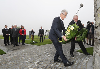 Martin McGuinness lays a wreath at the First World War monument in Flanders alongside Geert Bourgeois, Minister-President of Flanders.