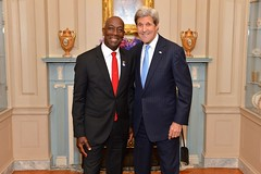 U.S. Secretary of State John Kerry poses for a photo with President Keith Rowley of Trinidad and Tobago at a reception that the Secretary hosted in honor of the 46th Annual Washington Conference on the Americas and the U.S.-Caribbean-Central American Energy Summit, at the U.S. Department of State in Washington, D.C., on May 3, 2016. [State Department photo/ Public Domain]